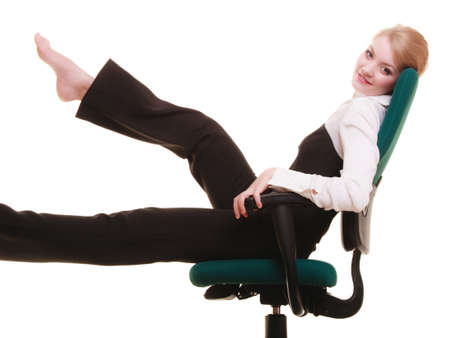 Break from work. Young businesswoman happy girl relaxing on chair isolated on white. Business. photo
