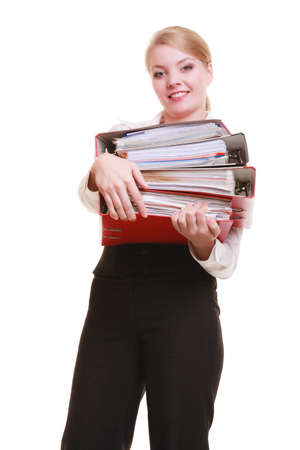 Business and paperwork. Busy businesswoman carrying stack of folders with files documents isolated on white. photo
