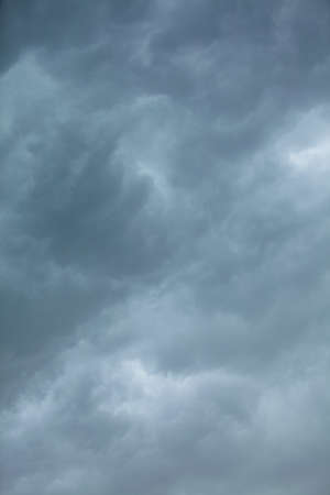 unease: Dramatic cloudscape. Dark stormy clouds covering the sky as nature background. Meteorology.