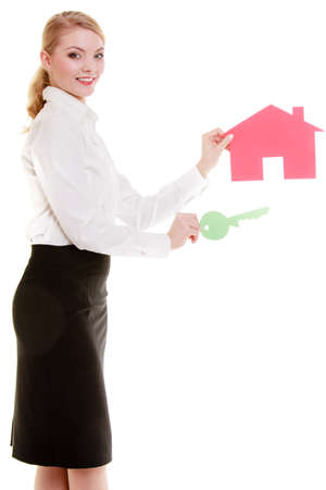 Woman real estate agent holding red paper house and key  Property business and accomodation or home buying ownership concept, isolated on white background