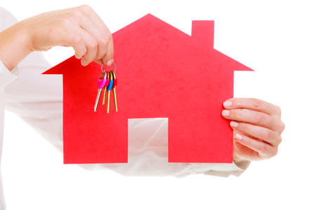 Woman real estate agent holding red paper house and keys  Property business and accomodation or home buying ownership concept, isolated on white background
