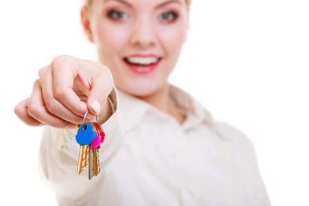 accommodation broker: Happy woman real estate agent holding set of keys to new house or car  Property business and accomodation or home buying ownership concept, isolated on white background Stock Photo