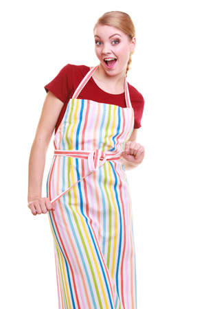 Funny housewife wearing kitchen apron or small business owner entrepreneur barista shop assistant  studio picture isolated on white photo