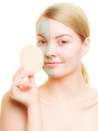 wellfare: Skin care  Woman removing clay mud mask isolated  Girl taking care of dry complexion  Beauty treatment