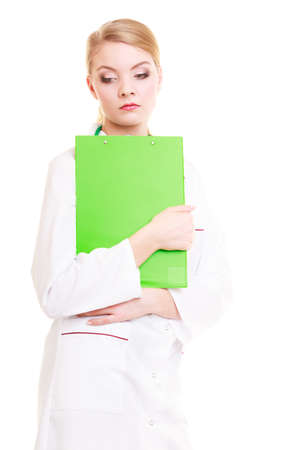 Portrait of woman in white lab coat with stethoscope. Doctor with clipboard isolated. Medical person for health insurance. photo