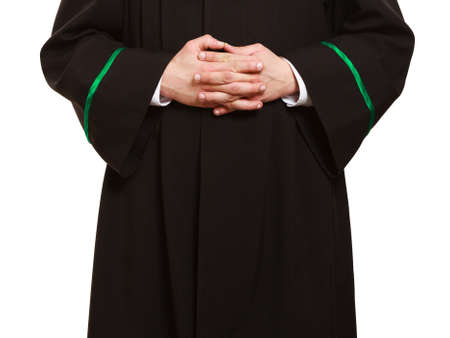 judicature: Law court and justice. Closeup of hands of man lawyer attorney in polish (Poland) black green gown isolated on white. Occupation.
