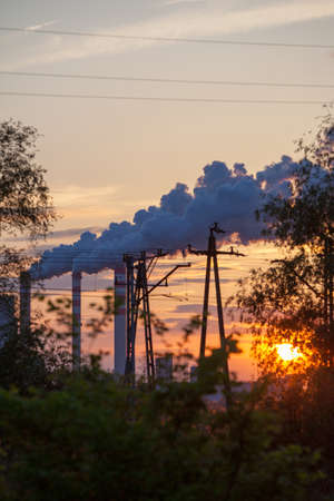 Energy. Smoke from chimney of power plant or station at the sunset. Industrial landscape. photo