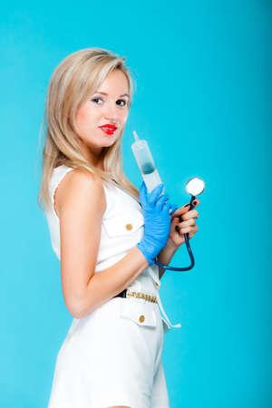 Funny sexy girl doctor nurse with syringe stethoscope.
