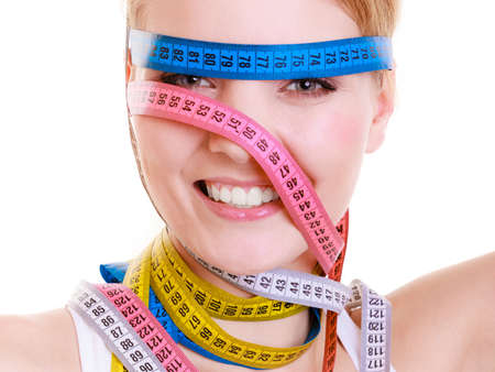 obsessed: Time for diet slimming weight loss concept  Health care healthy lifestyle  Sport fit fitness woman with a lot of colorful measure tapes around her head  Obsessed girl by your body   isolated on white