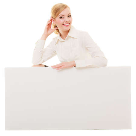 recommending: Advertisement  Young woman showing blank copy space banner isolated on white  Businesswoman recommending your product  Stock Photo