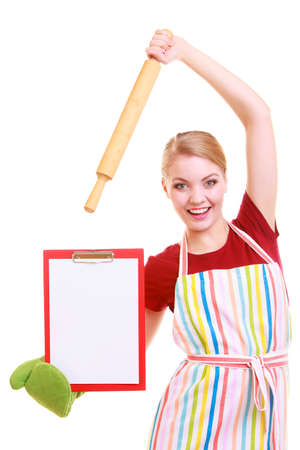 housewife wearing kitchen apron or small business owner entrepreneur cook chef shop assistant with empty blank banner sign for restaurant menu or recipe. Girl holding clipboard with copy space for text. Isolated on white photo