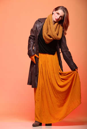 fresh girl: Fashion woman in autumn color fresh girl in full length long false orange eye-lashes Stock Photo