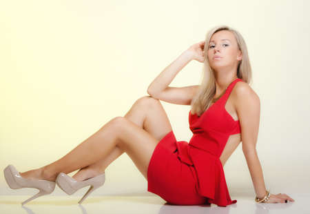 Girl in fashionable red dress posing.  photo
