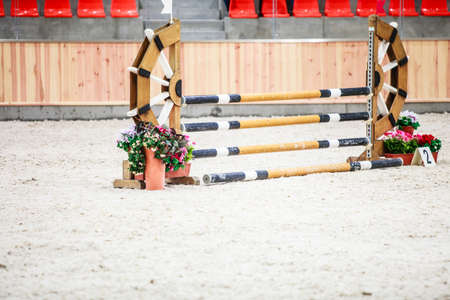 equitation: Equitation  Yellow blue white obstacle for jumping horses  Riding competition  Real