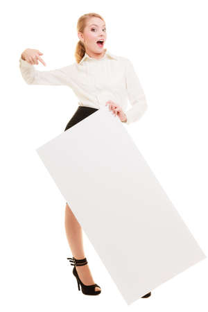 recommending: Advertisement. Elegant young woman holding blank copy space banner isolated on white. Businesswoman recommending your product. Stock Photo