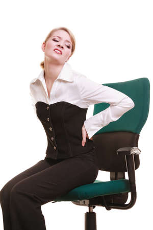 Business. Young businesswoman with backache. Woman with back pain isolated on white. Long working hours and health. photo