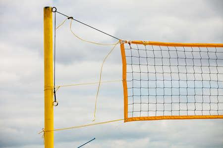 volleyball net: Volleyball summer sport equipment. Closeup of net netting wire on a sandy beach outdoor. Active lifestyle.