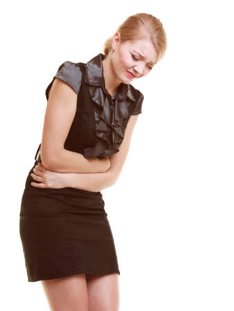 indigestion: Bellyache, indigestion or menstruation. Young woman girl suffering from stomach pain isolated on white. Stock Photo