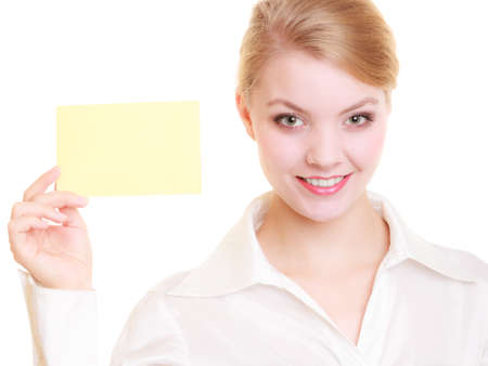 recommending: Advertisement  Young woman holding blank copy space yellow business card isolated on white  Businesswoman recommending your product