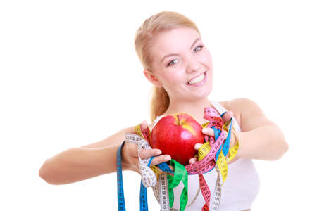 Time for diet slimming weight loss. Health care healthy lifestyle. Sport fitness woman fit girl holding a lot of colorful measure tapes and fruit isolated on white