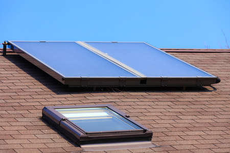 Renewable regenerative power and energy. Closeup of solar panel on troof of house. System of electricity generation. photo