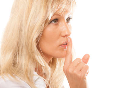 Woman asking for silence or secrecy with finger on lips hush hand gesture. Isolated photo