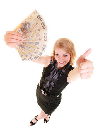 Happy business woman holding polish currency money banknote giving thumb up hand sign gesture. Finance and success. photo
