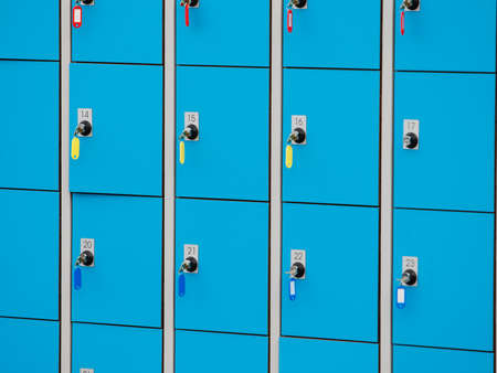 checkroom: closeup blue deposite boxes with keys. left luggage checkroom background