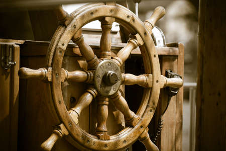 boat deck: Yachting. Sailboat view of different parts of yacht. Ship wooden old steering wheel.