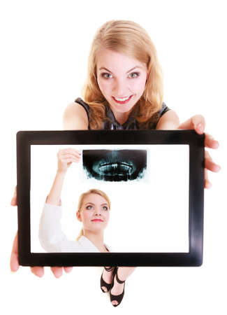 Happy girl medicine student showing ipad with photo of doctor with x-ray. Modern young woman holding tablet touchpad dreaming about be a physician. Isolated. Technology and medical health care. photo