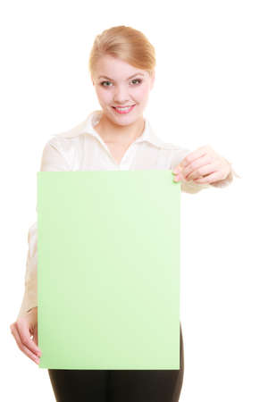 recommending: Advertisement. Young woman holding blank copy space green banner isolated on white. Businesswoman recommending your product