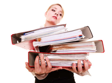 Business and paperwork  Tired overworked busy businesswoman carrying stack of folders with files documents isolated on white  photo