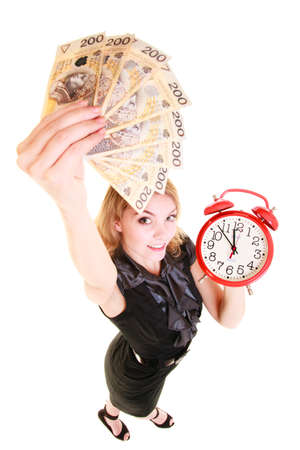 Happy business woman holding red alarm clock and polish currency money banknote  Finance time for investment or savings  photo