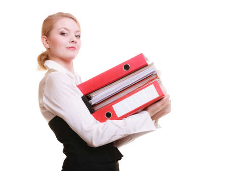 Business and paperwork  Busy businesswoman carrying stack of folders with files documents isolated on white  photo