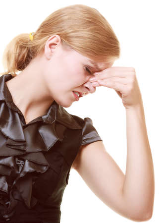 Headache, migraine and sinus ache  Stressed businesswoman worried young woman suffering from head or nose pain isolated on white  photo
