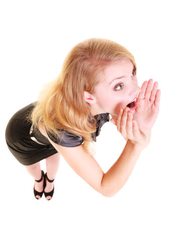 woman screaming: young woman blonde buisnesswoman in black dress shouting screaming. girl calling for help isolated on white