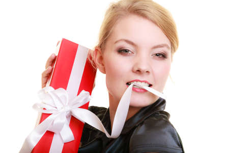 Holidays love and happiness concept - beautiful blonde girl with red gift box isolated photo