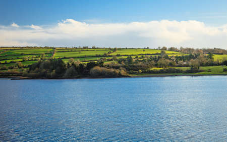 beautiful irish landscape green meadows at calm river Co.Cork, Ireland Europe photo