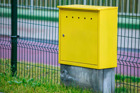outdoor electricity: Yellow electric control box outdoor. Urban power and energy. Supply electricity.