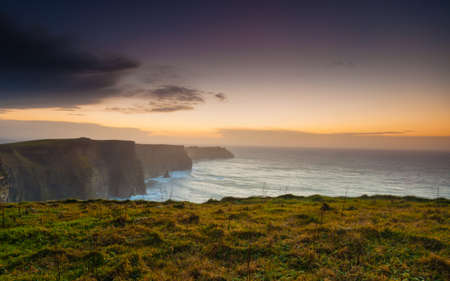 irish landscape: Famous cliffs of Moher at sunset in Co. Clare Ireland Stock Photo