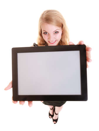 Technology. Elegant businesswoman blonde girl young woman showing blank copy space on screen tablet touchpad isolated on white. photo