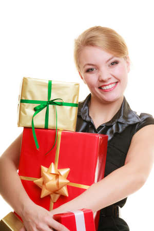 People celebrating holidays, love and happiness concept - beautiful blonde girl with golden red gift boxes isolated photo