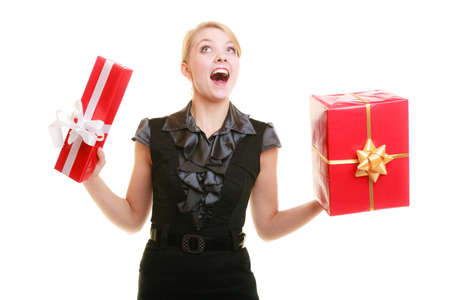 People celebrating holidays, love and happiness concept - excited blonde girl with red gift boxes isolated photo