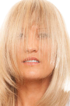 Healthy hair hairstyling hairdressing concept. Woman covering her face with long straight hair. photo