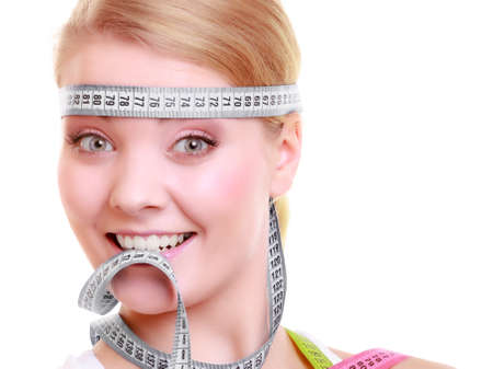 obsessed: Time for diet slimming weight loss. Health care healthy lifestyle. Fit fitness woman with gray measure tapes around her head. Obsessed girl by body isolated
