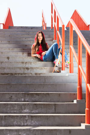 summer sport: Summer sport and active lifestyle. Cool teenage girl skater with skateboard on the stairs. Outdoor.