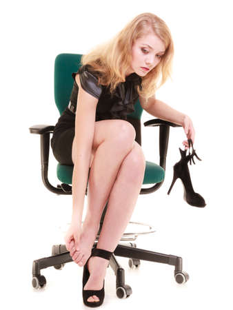 Work stoppage and leg pain. Tired businesswoman woman sitting on chair and massaging feet isolated on white. Business.