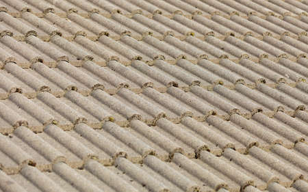 Brown stone tiles roof texture architecture background, detail of house close up photo
