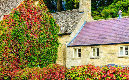 cotswold: BIBURY, ENGLAND, UK - SEPTEMBER 21, 2014: Traditional Cotswold cottages in Gloucestershire on September 21, 2014, England. Bibury it the most depicted village in the world.