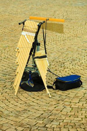 panpipe: Musical wind instrument, pan flute outdoor on street. Folk music